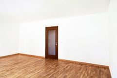 Empty room with closed door Stock Photography
