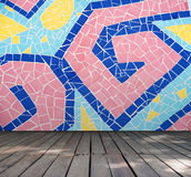 Empty room with Colorful mosaic tile wall and wooden floor interior background Royalty Free Stock Image