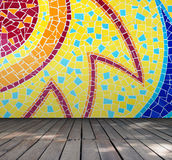 Empty room with Colorful mosaic tile wall and wooden floor interior background Stock Photo