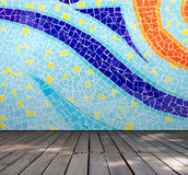 Empty room with Colorful mosaic tile wall and wooden floor interior background Royalty Free Stock Photo