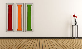 Empty room with colorful paintings on the walls Royalty Free Stock Photo