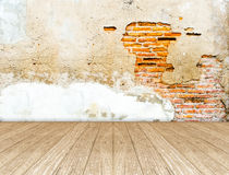 Empty room with crack brick wall and wooden floor Royalty Free Stock Images