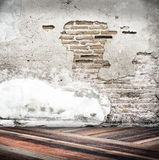 Empty room with crack cement wall and diagonal wooden floor,Temp Stock Photos