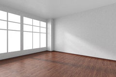 Empty room with dark wooden parquet floor, textured white walls Royalty Free Stock Photo