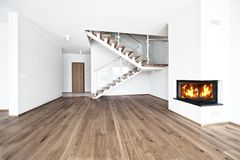 Empty room with fire place. Empty bright room with wood flore and fire place stock images