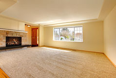 Empty room with fireplace Stock Photos
