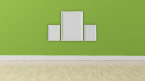 Empty room with green wall and blank frames Stock Photography