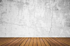 Empty room of grunge wall and wood floor Royalty Free Stock Images