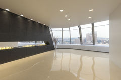 Empty room of a Highrise modern residence. With a city background Stock Images