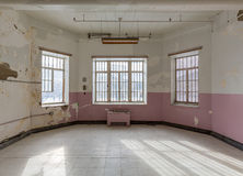 Empty room inside Trans-Allegheny Lunatic Asylum Royalty Free Stock Photos