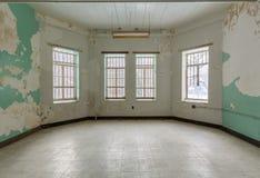 Empty room inside Trans-Allegheny Lunatic Asylum. Empty room with windows inside Trans-Allegheny Lunatic Asylum in Weston, West Virginia, USA stock photos