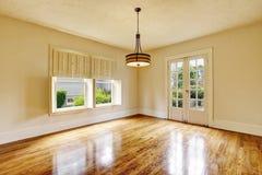 Empty room interior in beige tones and shiny hardwood floor. Northwest, USA Stock Photos