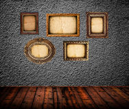 Empty room interior with black wall and vintage photo frames Royalty Free Stock Images