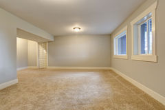 Empty room interior with blue tones walls and carpet floor. Stock Photography