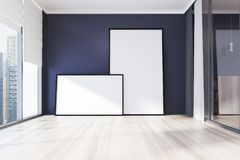 Empty blue room, two posters toned. Empty room interior with blue walls, a wooden floor, panoramic windows and two framed posters. 3d rendering mock up Stock Photography