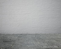 Empty room interior with brick wall and stone floor Royalty Free Stock Image