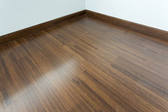 Empty room interior, brown wood laminate floor royalty free stock photo