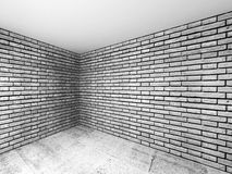 Empty room interior with gray brick walls, 3 d. Empty room interior with gray brick walls and concrete floor, 3d illustration with perspective effect Stock Photography