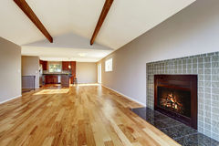 Empty room interior with hardwood floor, vaulted ceiling and fireplace Royalty Free Stock Photo