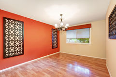 Empty room interior with latticework decor on the walls. Empty room interior with latticework decor on a red contrast wall.  Northwest, USA Stock Images