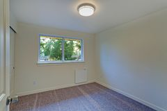 Empty room interior with milky walls and carpet floor. stock photos