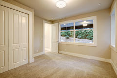 Empty room interior in new construction home. Empty room interior with wall to wall carpet in new construction home. Northwest, USA Stock Photos