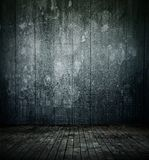 Empty room interior, old mottled concrete wall, dirty wooden floor stock photography