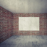 Empty room interior with red brick walls and empty white poster Royalty Free Stock Image