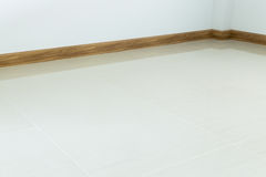 Empty room interior, white tile floor and white mortar wall Royalty Free Stock Photos