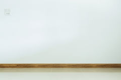 Empty room interior, white tile floor and white mortar wall Royalty Free Stock Image