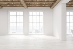 Empty room with large windows. Empty room interior with white walls, a wooden floor and ceiling and large loft windows. 3d rendering mock up Stock Images