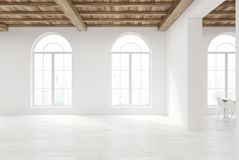 Empty room with large rounded windows. Empty room interior with white walls, a wooden floor and ceiling and large rounded windows. 3d rendering mock up Stock Photography