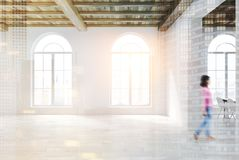 Empty room with large rounded windows double. Empty room interior with white walls, a wooden floor and ceiling and large rounded windows. A woman. 3d rendering Royalty Free Stock Images