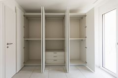 Empty room with large wardrobe. And window. Nobody inside stock images