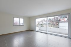 Empty room with large window on the balcony. Empty space stock photo
