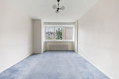 Empty Room. Empty living room with window, white walls and blue carpet Stock Photography