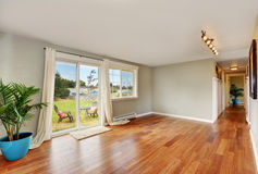 Empty room with long corridor and exit to the back yard. Royalty Free Stock Photography