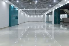 Empty room in modern commercial building. Led lamps are installed on shop square shape ceiling in commercial building stock image