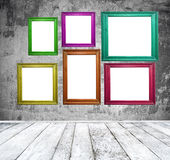Empty room with multicolored photo frames Stock Photos