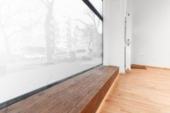 Empty room newly renovated - store / shop with wooden floor and Stock Photo