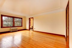 Empty room in an old apartment with beautiful hardwood. Stock Image