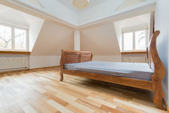 Empty room with old fashioned bed Stock Photo