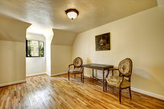 Empty room in old house with antique carved wood furniture Royalty Free Stock Images