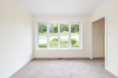 Empty Room Overlooking Backyard Stock Photography