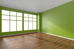 Empty room with parquet floor, green textured walls and big wind Stock Photos