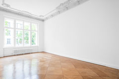 Empty room with parquet floor , white walls and stucco ceiling. New renovated flat in old building Royalty Free Stock Photos