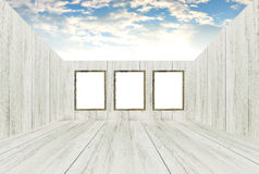 Empty room with picture frames and open roof. Royalty Free Stock Images