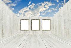 Empty room with picture frames and open roof. Empty room with picture frames and open roof looked to sky Royalty Free Stock Image