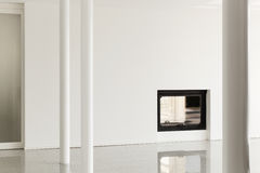 Empty room with pillar and fireplace Royalty Free Stock Images
