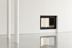 Empty room with pillar and fireplace Stock Photography